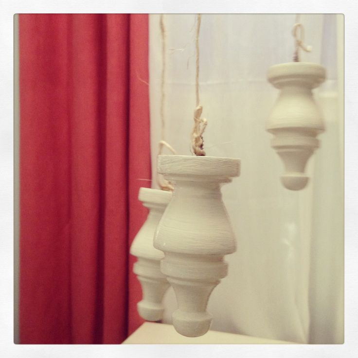 Painted finials to hang photos from