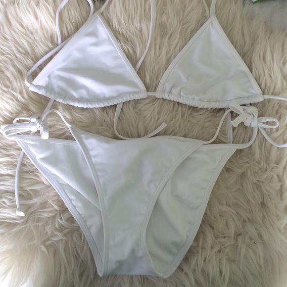 NWOT white Victoria Secret triangle bikini White triangle bikini top and bottoms with adjustable tie strings for the top and bottom Victoria's Secret Swim Bikinis