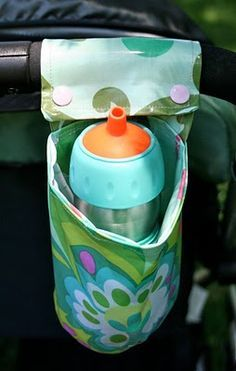 snap on cup holder. I am going to have to make one of these. would be great for walkers and wheelchairs too!