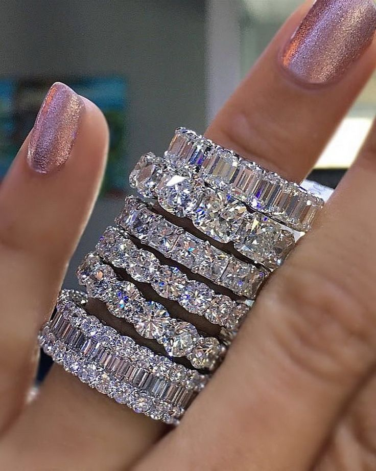 Now THAT is a stack.  What diamond eternity band do you prefer? Emerald, round, cushion, radiant? Tell us below  #diamondring #diamonds #engagementrings #trophywife