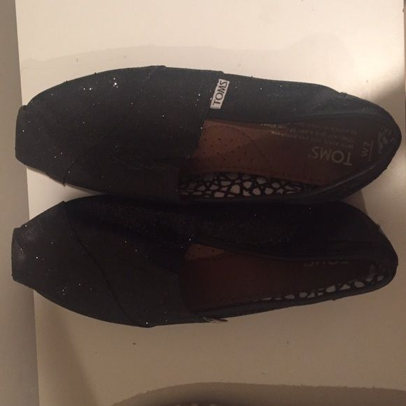 Black Glitter Toms Black glitter Toms. Size 7. Mod wear. Can be bundled with other Toms for discount. TOMS Shoes Flats & Loafers
