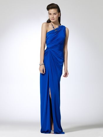 Shiny jersey one shoulder dress with side ruching and knot. Hidden side zipper. 62 inch body length95% polyester, 5% spandexLining: 100% polyesterImportDry clean only