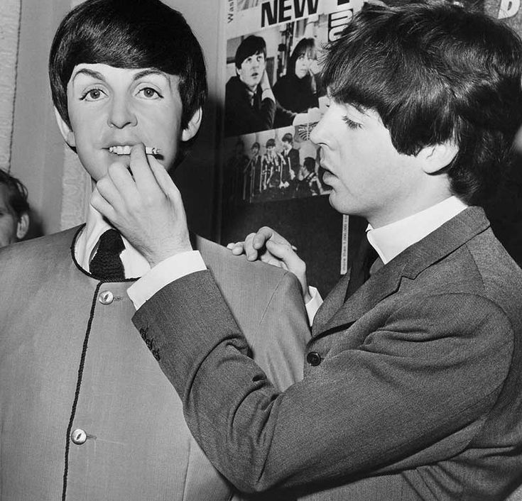 Paul McCartney with his wax statue at Madame Tussauds in London