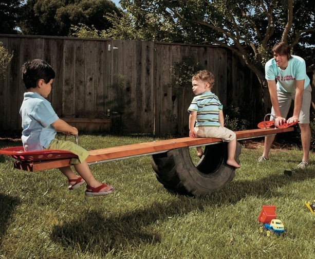 See Saw made using 1/2 a tire and tractor seats..We have plenty of tires and one tractor seat.