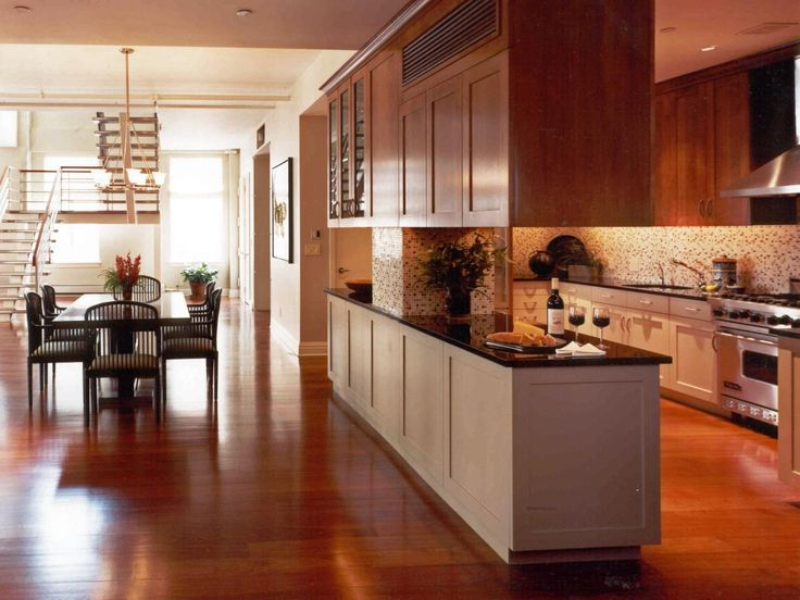This Spacious Galley Style Kitchen Features Stained Wood
