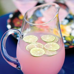 Pink Lemonade    Ingredients  1 half-gallon store-bought pink lemonade $  2 limes, thinly sliced $  Preparation    Pour the lemonade into a large pitcher. Add the limes and stir to combine. Serve over ice.     Tip: Make pink lemonade extra colorful (and keep it cool) by adding a 10-ounce package of frozen berries to the pitcher before serving. (Frozen strawberries, raspberries, and blueberries all work.)