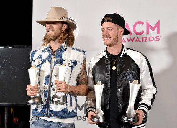 Tyler Hubbard Photos Photos - Musicians Brian Kelley (L) and Tyler Hubbard of the music group Florida Georgia Line, winners of the award for Vocal Event of the Year and Single Record of the Year, pose in the press room during the 52nd Academy Of Country Music Awards at T-Mobile Arena on April 2, 2017 in Las Vegas, Nevada. - 52nd Academy of Country Music Awards - Press Room