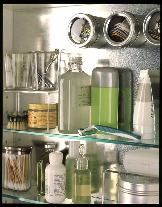 Bathroom medicine cabinet organization. magnetic metal lining, magnetic spice tins to hold small items