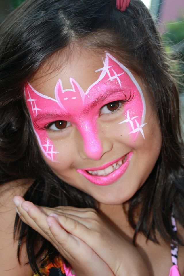 Bat girl face paint design painted by Cynnamon in Claremont  www.facepaintingbycynnamon.com
