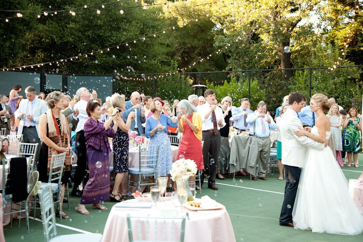 A reception on a tennis court?!?! LOVE THIS!!!!