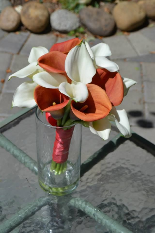Classic orange and white calla lily bridal bouquet. Fleurish Floral Designs