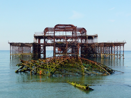 The West Pier, Brighton The West Pier was built in 1866 by Eugenius Birch and has been closed and deteriorating since 1975. The pier caught fire in 2003. Firefighters were unable to save the building from destruction because the collapsed walkway prevented them from reaching it. High winds caused the middle of the pier to collapse completely in June 2004. Hopes for restoring the pier have now ceased.