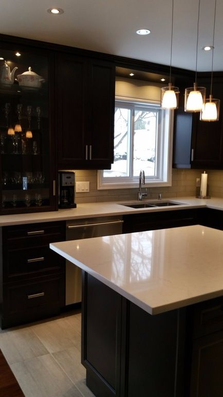 Decorate your kitchen to be stylish and convenient with a U shaped design, white counter tops and dark cabinets! Discover more fabulous kitchen options with SCD Design & Construction!