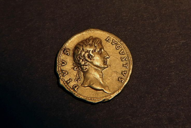 "A 24 karat gold coin that was minted in Rome in 107 CE and bears the portrait of the emperor ""Augustus Deified"", minted by Emperor Trajan in Rome in 107 CE. GALI TIBBON / AFP."