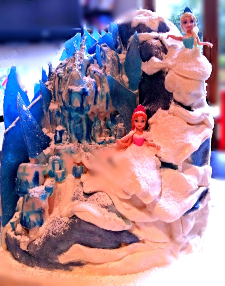 Elsa's castle Chocolate biscuit cake with homemade quinoa digestive biscuits, marshmallow find an and peppermint ice!