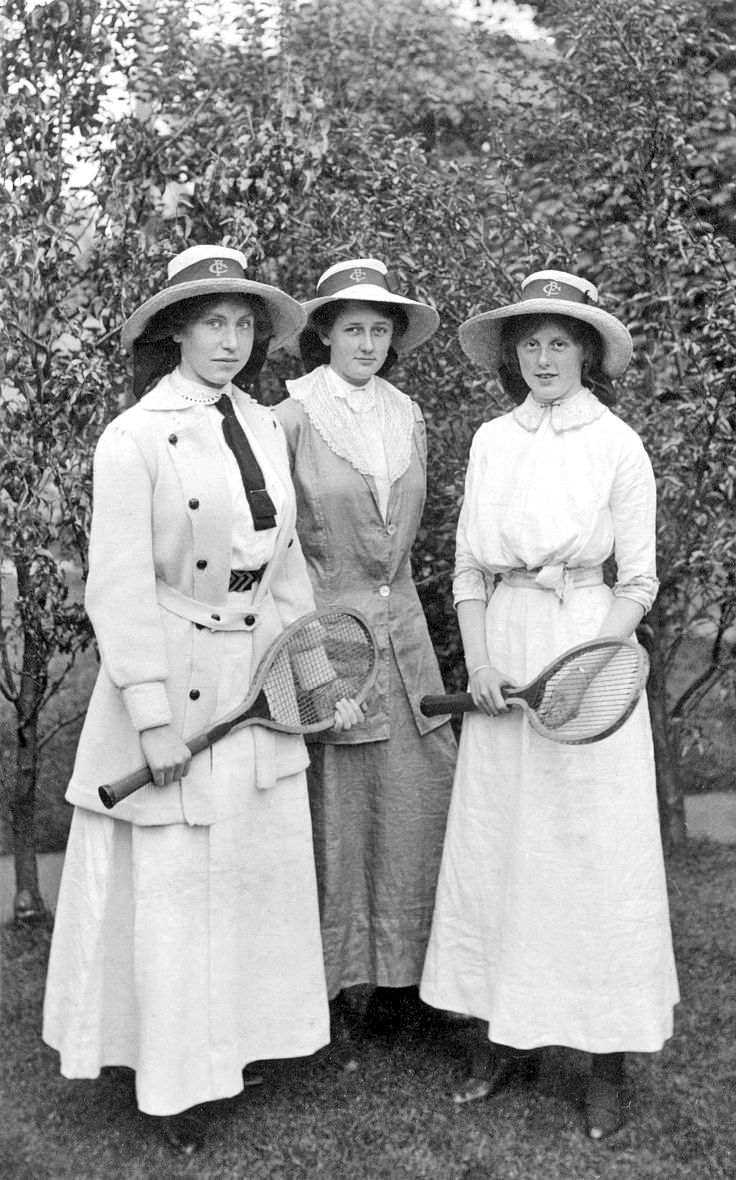 Three young women with tennis rackets History in Photos: Tennis