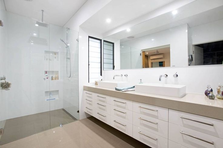 A great family ensuite from Gary Keen Design and Forrest Building Co in the NT! Double basins for a smooth run in the morning, a tonne of storage and a spacious shower for everyone.
