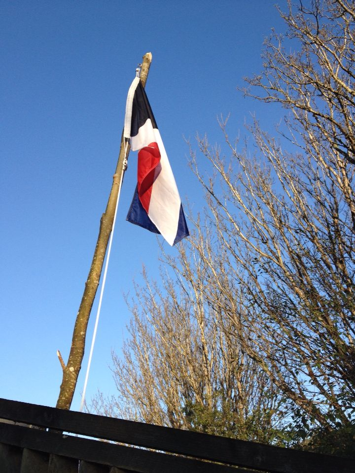 First to the Light flag in light morning air, Dunedin, NZ (Also known as Red Peak)