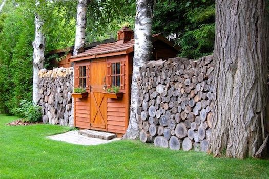 There's a fairytale-quality about this enchanting forest retreat - the garden walls of stacked wood appeal to me. (Did I mention I'm a virgo?)