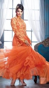 Give in to the exotic look like Mugdha Godse wearing this designer gown style ankle length anarkali suit which is made by orange color, georgette fabric. This  suit is beautified with stone, resham embroidery work on the long koti style and fancy zip work in the center panel. This exclusive suit comes with matching bottom and dupatta.This Salwar Kameez can be stitched in the maximum bust size of 4..