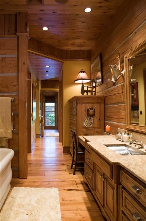 The master bath makes use of built in storage areas | Handcrafted Dovetail Log Home | Caribou Creek Log and Timber