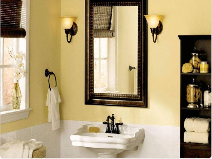 Classic Wood Framed Wall Mirror and Pedestal Sink near Cream Bathroom Paint Ideas