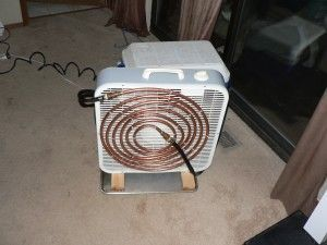 DIY Air conditioner. Box fan, cooler, pump, copper tubing, and ice water. Uses concept of evaporative cooling to cool a single room. Badass!!