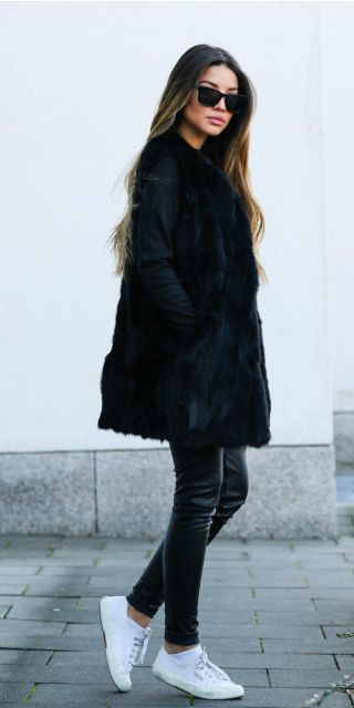 You can never go wrong with an all black outfit. Consuelo Paloma rocks this edgy style in leather leggings, a simple black tee, and a faux fur vest coat; an easily achievable winter look.   Vest: Neat.to, Top: Shein, Leggings: H&M, Sneakers: Superga.