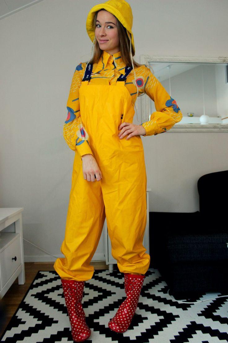 Girl in yellow bib pants and polka dot rain boots.