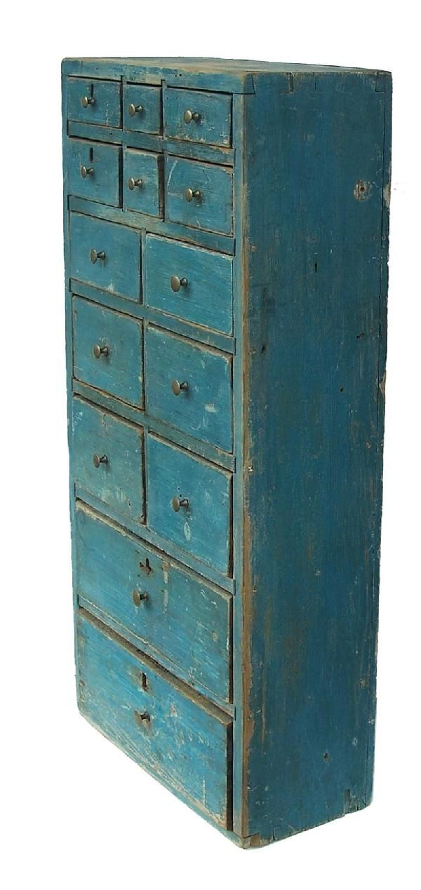 Early 19th century Lancaster Co. Pennsylvania blue painted hanging Apothecary, with dovetailed case and drawers, divers are mortised into the top and sides. graduating drawer circa 1840   Measurements are 17″ wide x 36″ tall x 8″ deepCarina Case