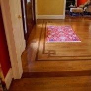 Inlaid design can add definition to entry or room