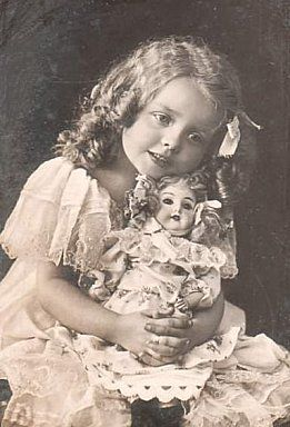 Lovely photo of a little girl with her doll. Vintage and antique dolls on Ruby Lane www.rubylane.com #dolls #vintagedolls