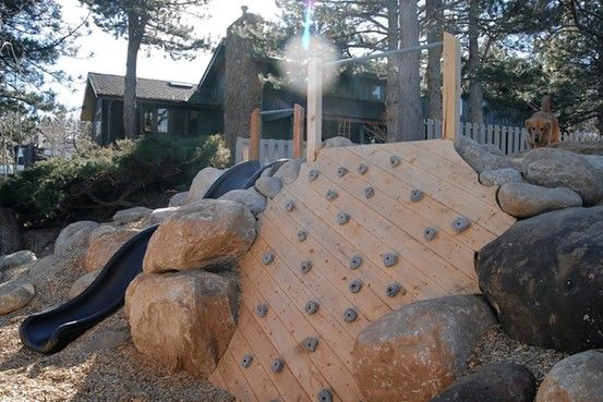 Interesting use of hill with embankment slide and climbing wall.