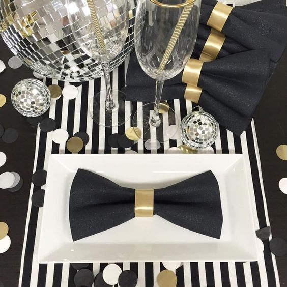 DIY: make bow tie napkins for that a tuxedo look. Love this idea for a formal party or an Awards Show party.