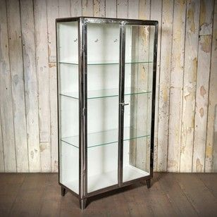 An original pair of vintage industrial cabinets with a high polish finish. This Midcentury medicine cabinet has a simple style with curved edges and…
