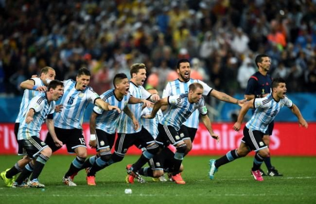 Netherlands v Argentina: Semi Final - 2014 FIFA World Cup Brazil SAO PAULO, BRAZIL - JULY 09: Lionel Messi (1st L) and players of Argentina dash to celebrate the win as Maxi Rodriguez scores in the penalty shootout in the 2014 FIFA World Cup Brazil Semi Final match between Netherlands and Argentina at Arena de Sao Paulo on July 9, 2014 in Sao Paulo, Brazil. (Photo by Mike Hewitt - FIFA/FIFA via Getty Images)