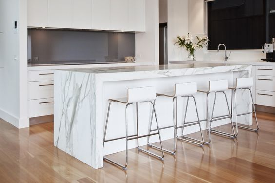 calacatta quartz quantum quartz island benchtop with mitred apron edging and waterfall: