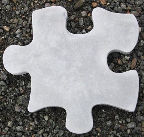 Cute idea! Puzzle piece pavers in the backyard.