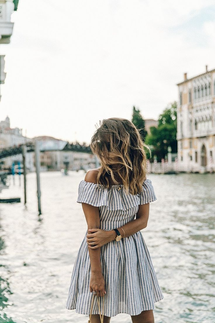 off the shoulder ruffled dress with pin stripes.