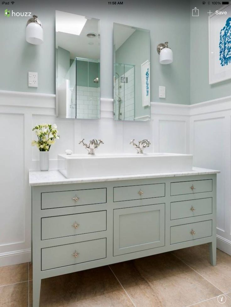 Calming colors and cool finishes create a tranquil effect in this bathroom.