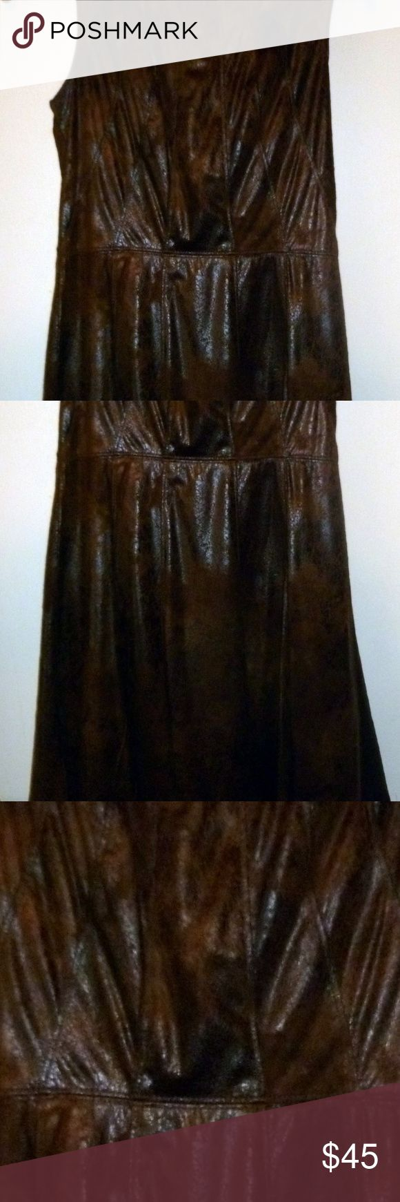 Vince Camuto Dress in Woman SZ 2 A  BNWT beautiful faux suede Vince Camuto brown dress in size Petite 2 that goes about to the knees or slightly above.. It does have a lining, with zip up back. Vince Camuto Dresses Midi