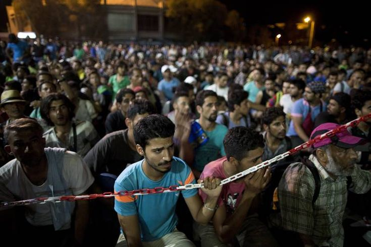 Syrians waiting at the port at the Greek island of Lesbos to board a ferry...