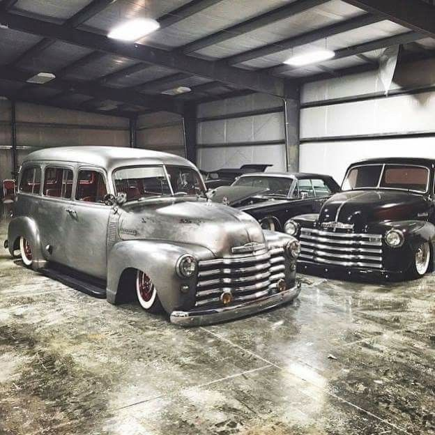chev chevy chevrolet advanced design suburban slammed in the weeds laid out over wide white wall tires in a bare steel finish