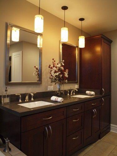 like pendant lighting in bathroom and vanity storage arrangement