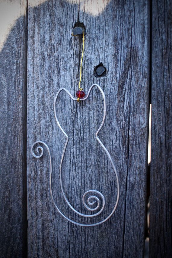 Well crafted cat or dog wire ornaments are handmade to order with care and precision. Wire ornaments are made out of silver aluminum wire, and are approximately 4 inches in height nomadblue.shop