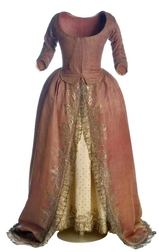 Vestido vaquero [rough translation: cowboy dress], c.1790, Madrid, dark rose satin silk with ivory underskirt with silver metallic embroidery. Popular in the last decade of the eighteenth century. (c) Museo del Traje.