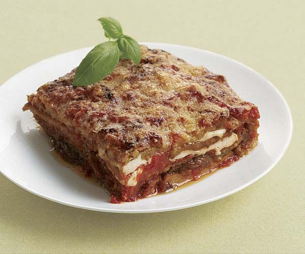 Classic Eggplant Parmigiana - This is how they do eggplant parmigiana in Italy: no breading and no puddles of cheese, just thin layers of fried eggplant with homemade sauce, fresh mozzarella, and Parmigiano-Reggiano. It's a great option for lasagna-loving families looking for delicious ways to eat less meat.