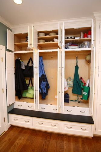 This kitchen mudroom built-in has it all ~ storage, seating, and the best part?Individual lockers with doors that close to hide the contents.