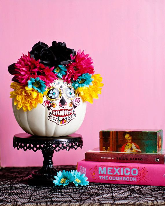 "Melodrama's household celebrates both Halloween and Dia de los Muertos. So she combined the two holidays by creating a Calaveras/Sugar Skull themed pumpkin. It looks super chic, and reminds us of the movie ""Book of Life."" Pumpkin decorated by Krys Melo. Shop Martha Stewart Crafts"
