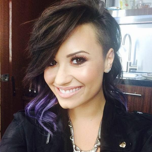 Demi Lovato can seriously rock any hairstyle! I love how she always has a different color in there like blue, pink and my fave purple!!! So ba with the shaved head and rockin fashion! Her face is perfect